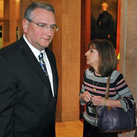 Alan Pierce,left, and client Shelly Raucci, right, leave the Court of Appeals in Albany, N.Y., following arguments Thursday Jan. 3, 2013, on whether the wife of the former Schenectady school official Steven C. Raucci should be allowed to receive $5,800 in monthly pension checks her husband was receiving from the New York State and Local Employees' Retirement System. (John Carl D'Annibale / Times Union) Photo: John Carl D'Annibale / 00020637A