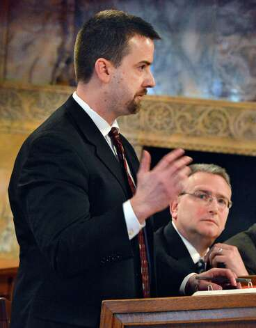 Assistant Solicitor General Owen Demuth, left, and Alan Pierce, right, represent Steven and Shelly Raucci during arguments, Thursday Jan. 3, 2013, before the Court of Appeals In Albany, N.Y., on whether the wife of the former Schenectady school official Steven C. Raucci should be allowed to receive $5,800 in monthly pension checks her husband was receiving from the New York State and Local Employees' Retirement System. (John Carl D'Annibale / Times Union) Photo: John Carl D'Annibale / 00020637A
