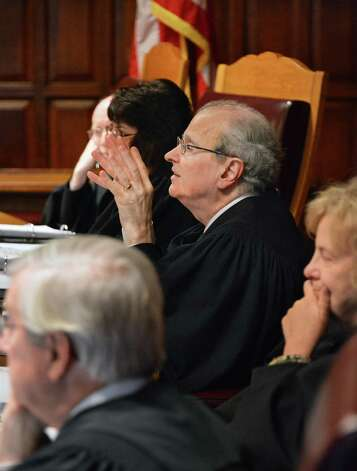 Court of Appeals Chief Judge Jonathan Lippman, center, listens Thursday Jan. 3, 2013, during arguments before the Court of Appeals in Albany N.Y., on whether the wife of the former Schenectady school official Steven C. Raucci should be allowed to receive $5,800 in monthly pension checks her husband was receiving from the New York State and Local Employees' Retirement System. (John Carl D'Annibale / Times Union) Photo: John Carl D'Annibale / 00020637A