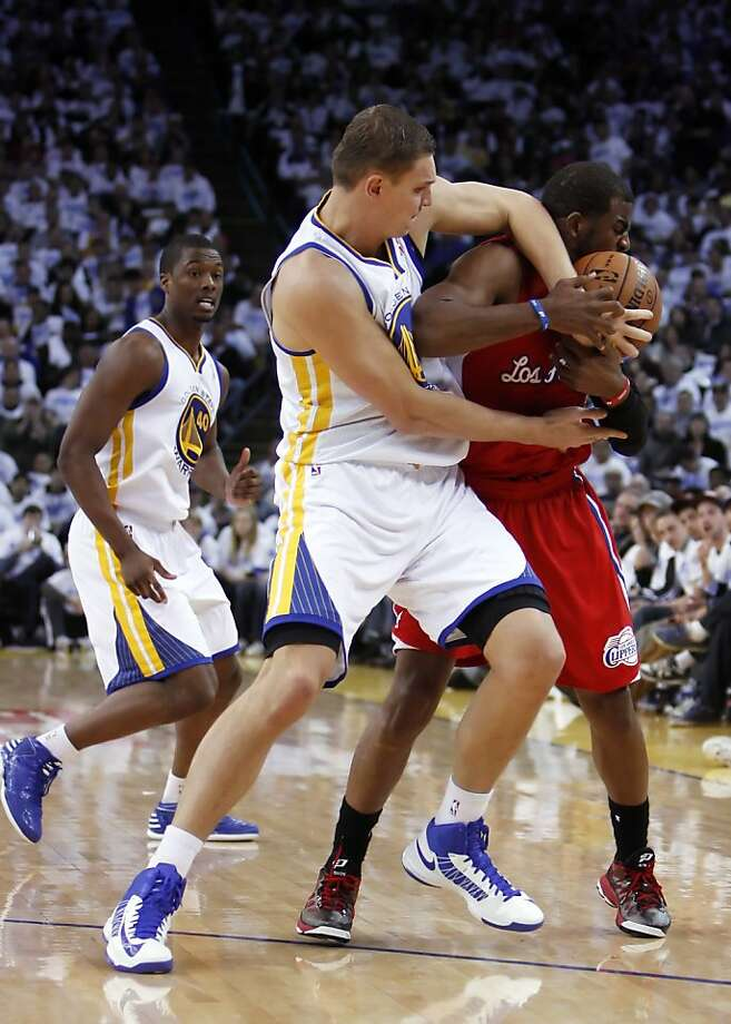 Andris Biedrins fouls Chris Paul in a tough game followed by respectful talk. Photo: Carlos Avila Gonzalez, The Chronicle