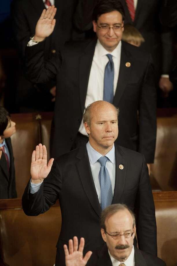 Rep. Pete Gallego (top) is sworn into Congress as the Democratic representative of Texas' 23rd district on Jan. 3, 2013, in Washington.
