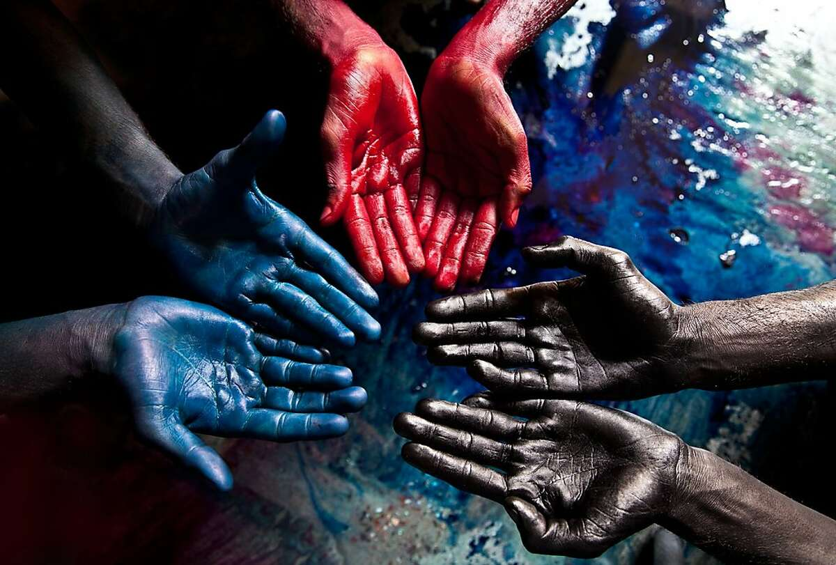 A family portrait in India, father (black hands) and sons are enslaved in a silk dyeing factory where toxic chemicals are used in the dyes.