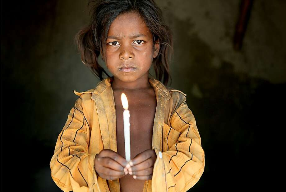 A young girl in India is among the many children forced into slavery that Lisa Kristine has photographed throughout the world. Photo: Lisa Kristine, Lisa Kristine Photography