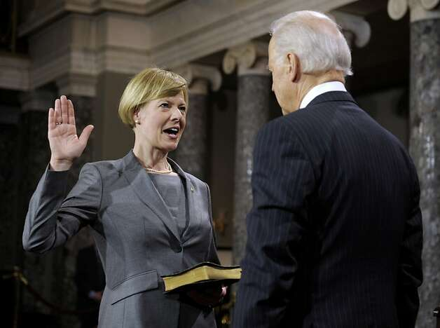 Tammy Baldwin, a Wisconsin Democrat who became the first openly gay senator, gets sworn in by Vice President Joe Biden. Photo: Cliff Owen, Associated Press