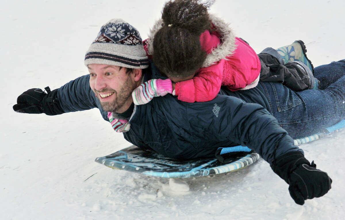 Bethel High School300 Whittlesey Dr, Bethel, CT Five-year-old Ascha Wallace hangs on to her dad, Rob Wallace, while sledding down a hill adjacent to Bethel High School on Thursday, Jan. 3, 2013.