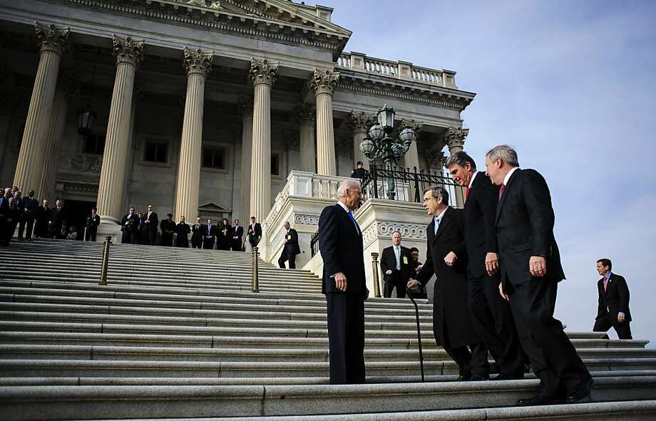 "U.S. Vice President Joseph ""Joe"" Biden, left, greets Senator Joe Manchin, a Democrat from West Virginia, second right, and Senator Mark Kirk, a Republican from Illinois, second left, on the steps of the U.S. Capitol in Washington, D.C., U.S., on Thursday, Jan. 3, 2013. Kirk returned for the first time since he suffered a stroke on Jan. 23, 2012. The 113th Congress convenes today in Washington where new members will try to meld their diverse backgrounds in a legislature containing a record seven openly gay lawmakers, an unprecedented 20 women in the Senate and the first all-female state delegation, from New Hampshire. Photo: Pete Marovich, Bloomberg"