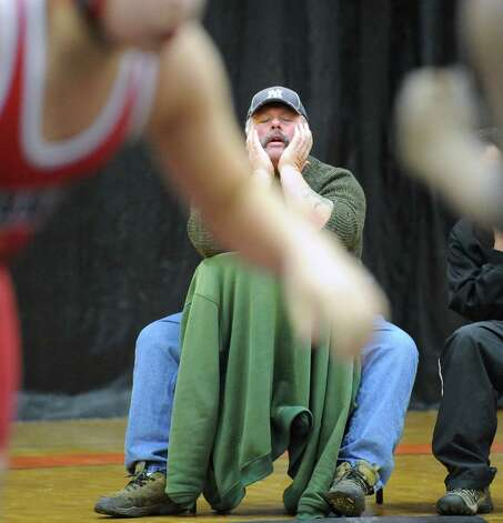 Stamford wrestling head coach Tim Donnelly reacts during the boys high school wrestling match between Stamford and Greenwich at Stamford High School, Thursday night, Jan. 3, 2013. Photo: Bob Luckey / Greenwich Time