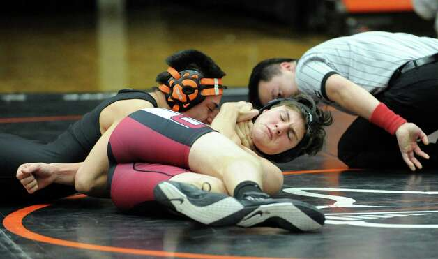 Christian Llanos of Stamford gets the better of Dan Gutman, right, of Greenwich, in the 145 pound match that Llanos won during the boys high school wrestling match between Stamford and Greenwich at Stamford High School, Thursday night, Jan. 3, 2013. Photo: Bob Luckey / Greenwich Time
