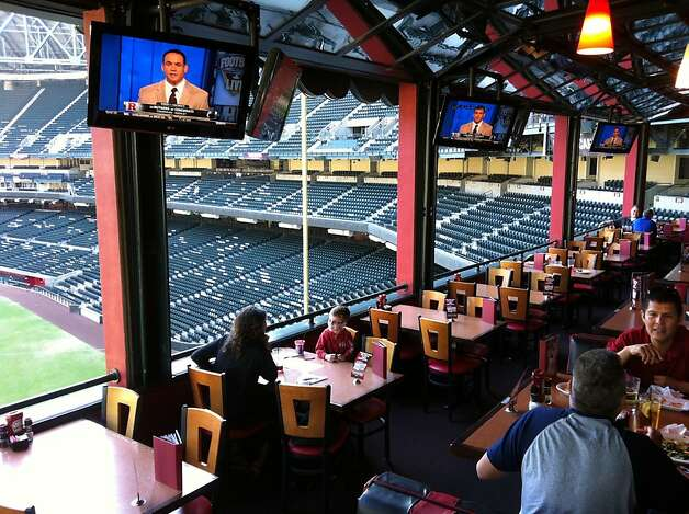 The TGI Fridays restaurant inside Chase Field gives diners a glimpse of the baseball field year-round, even when the Diamondbacks aren't playing. Photo: Spud Hilton, The Chronicle