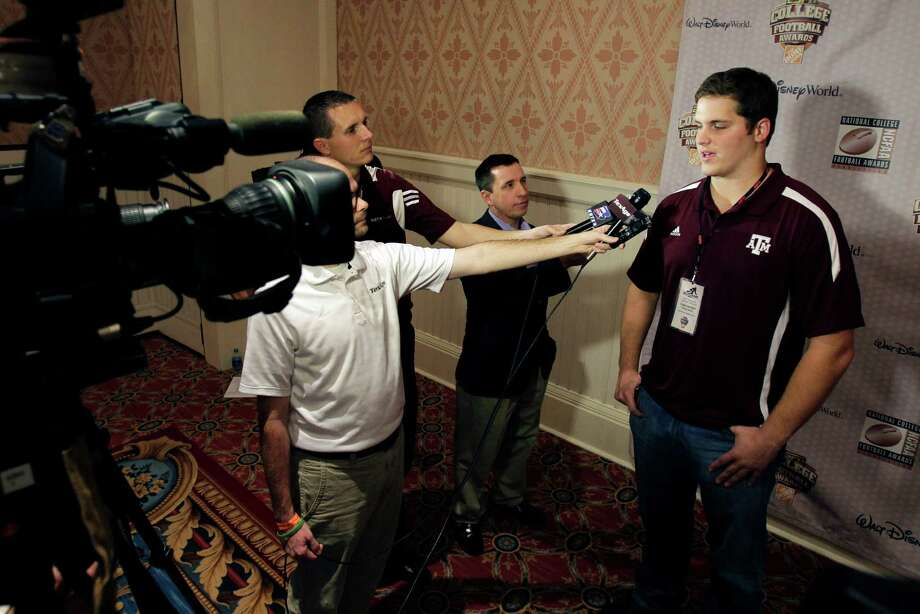 Texas A&M offensive lineman Luke Joeckel, right, speaks with reporters during a media event prior to the College Football Awards show, Wednesday, Dec. 5, 2012, in Lake Buena Vista, Fla. (AP Photo/John Raoux) Photo: John Raoux, Express-News / AP
