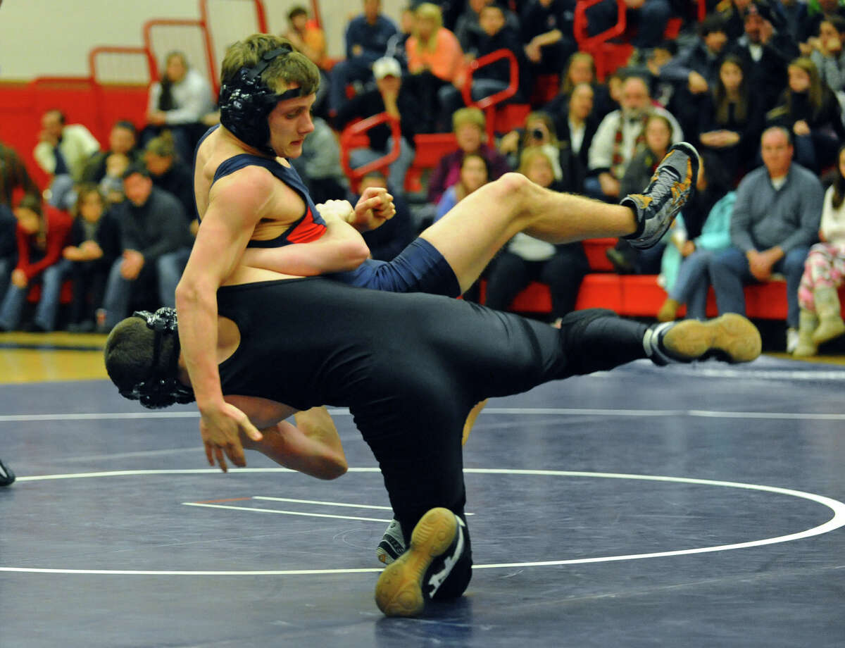 JJonathan Law's Collin Carollo takes down Foran's Patrick Fitzgerald, during wrestling action in Milford Conn. on Thursday January 3, 2012.