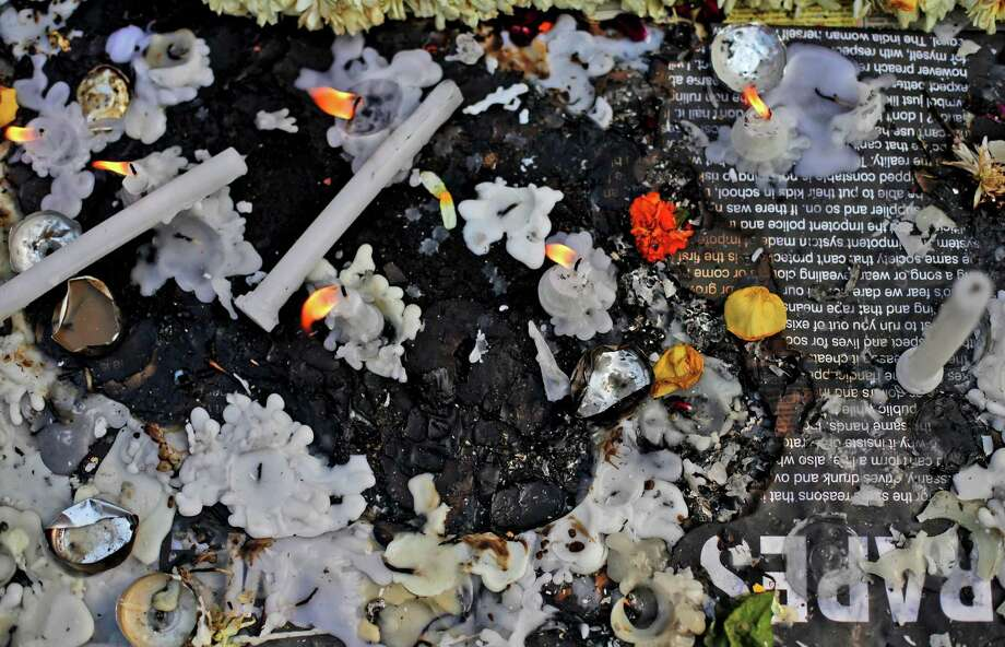 Candles stand lit at a makeshift memorial for a gang-rape victim in New Delhi, India, Thursday, Jan. 3, 2013. Indian police were preparing Thursday to file rape and murder charges against a group of men accused of sexually assaulting the 23-year-old university student for hours on a moving bus in New Delhi. The Dec. 16 attack on the woman, who later died of her injuries, has caused outrage across India, sparking protests and demands for tough new rape laws, better police protection for women and a sustained campaign to change society's views about women. (AP Photo/Altaf Qadri) Photo: Altaf Qadri