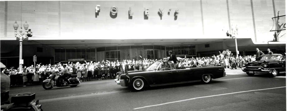 President John F. Kennedy greets Houstonians as his motorcade drives past Foley's in 1962. Photo: Houston Chronicle / Houston Chronicle
