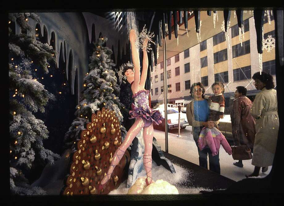 "Foley's brings back animated windows for the Christmas season. Pedestrians pass by the ""Land of Snow"" scene from the Nutcracker Ballet. Each of the four windows on Main Street displays a different stage set with animated characters from the Nutcracker Ballet. Photo: Micheal Boddy, Houston Chronicle / Houston Post files"