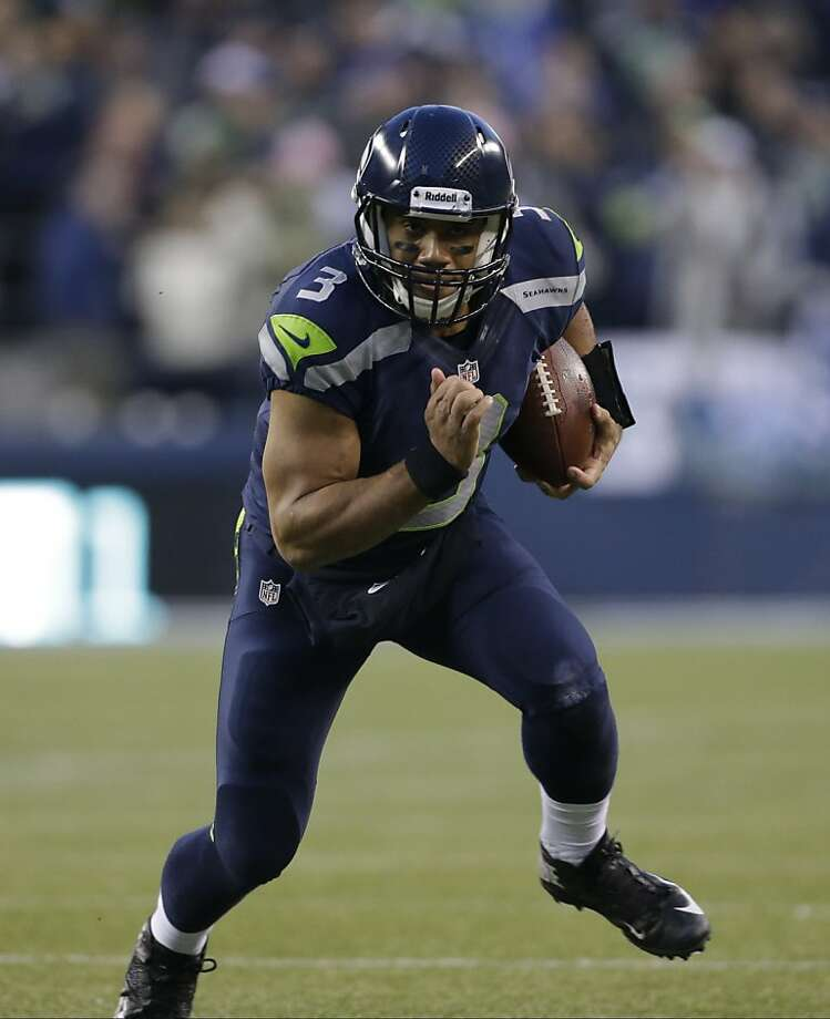 Seattle's Wilson passed for 3,118 yards with 26 touchdowns. Photo: Elaine Thompson, Associated Press
