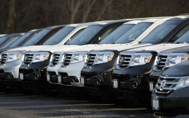 In this Wednesday, Dec. 5, 2012, photo, Honda Pilots are seen outside of a Honda car dealership in Des Plaines, Ill. The U.S. auto industry ended 2012 on a high note, with December sales the strongest they have been since before the recession. Analysts predict an even bigger year in 2013, as a stronger economy, low-interest rates, aging cars on the road and competitive new products continue to draw buyers to dealerships.  (AP Photo/Nam Y. Huh) Photo: Nam Y. Huh
