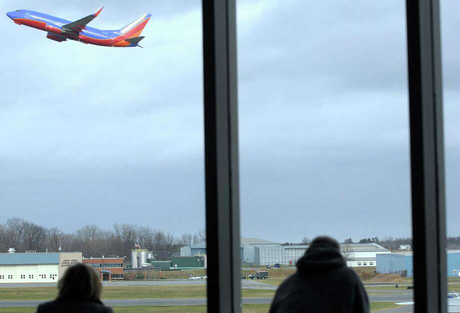 People in the observation deck at the Albany International Airport watch as a plane takes off on Sunday, Nov. 25, 2012 in Colonie, NY.  (Paul Buckowski / Times Union) Photo: Paul Buckowski / 00020229A