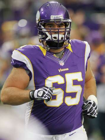 Minnesota Vikings center John Sullivan (65) emerges through the smoke before the first half of an NFL preseason football  against the Buffalo Bills Friday, Aug. 17, 2012 in Minneapolis. (AP Photo/Andy King) Photo: Andy King, ASSOCIATED PRESS / AP2012