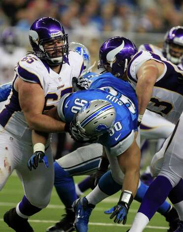 Detroit Lions defensive tackle Ndamukong Suh (90) is double teamed by Minnesota Vikings center John Sullivan (65) and guard Brandon Fusco (63) during the third quarter of an NFL football game at Ford Field in Detroit, Sunday, Sept. 30, 2012. (AP Photo/Carlos Osorio) Photo: Carlos Osorio, ASSOCIATED PRESS / AP2012