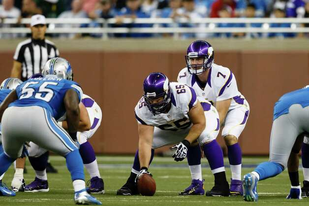 Minnesota Vikings quarterback Christian Ponder (7) gets set behind center John Sullivan (65) during an NFL game against the Detroit Lions at Ford Field in Detroit, Sunday, Sept. 30, 2012. (AP Photo/Rick Osentoski) Photo: Rick Osentoski, ASSOCIATED PRESS / Rick Osentoski2012