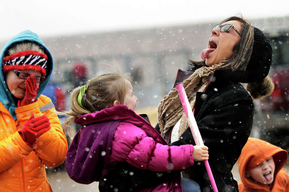 Kids take a break from preparing their Herefords for a stock show to play in the first snowfall of the year, Thursday Jan. 3, 2013 outside of the Ector County Coliseum. Photo: Edyta Blaszczyk, Associated Press / Odessa American