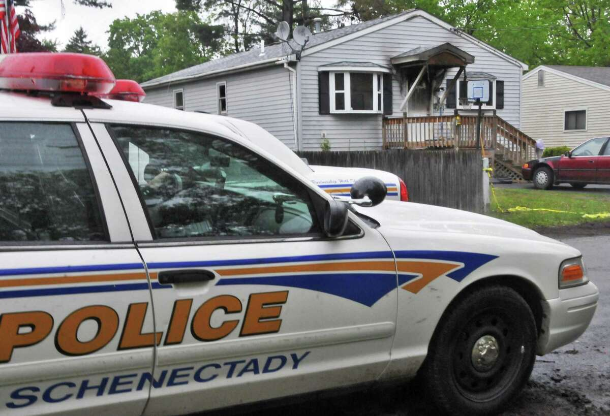 Schenectady police at the scene of a home fire on Chiswell Road Wednesday morning May 12, 2010, in Schenectady, N.Y. The Civil Rights Division of the U.S. Justice Department has closed a decade-long probe of the city police force after concluding that the department has adequately addressed concerns related to the use of excessive force, illegal searches and seizures and other issues. (John Carl D'Annibale / Times Union archive)