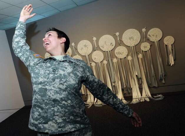 Army Private Caitlin Murray of Nassau pretends to throw a bouquet after marrying Sean Whitney of Niskayuna Thursday Jan. 3, 2013, at the Albany International Airport in Colonie, N.Y. (Michael P. Farrell/Times Union) Photo: Michael P. Farrell