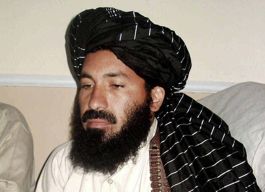 ALTERNATE CROP - In this April, 20, 2007 file photo, Pakistani militant commander Maulvi Nazir meets his associates in South Waziristan, Pakistan near the Afghani border. Five Pakistani security officials said the commander, Nazir, was reportedly among nine people killed in a missile strike on a house in the village of Angoor Adda in the South Waziristan tribal region early Thursday. The officials spoke on condition of anonymity because they were not authorized to brief the media. (AP Photo/Ishtiaq Mahsud) Photo: Ishtiaq Mahsud