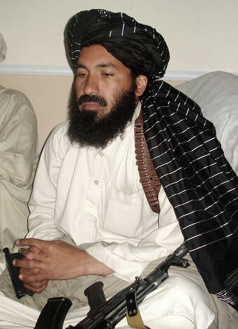 In this April, 20, 2007 file photo, Pakistani militant commander Maulvi Nazir meets his associates in South Waziristan, Pakistan near the Afghani border. Five Pakistani security officials said the commander, Nazir, was reportedly among nine people killed in a missile strike on a house in the village of Angoor Adda in the South Waziristan tribal region early Thursday. The officials spoke on condition of anonymity because they were not authorized to brief the media. (AP Photo/Ishtiaq Mahsud) Photo: Ishtiaq Mahsud