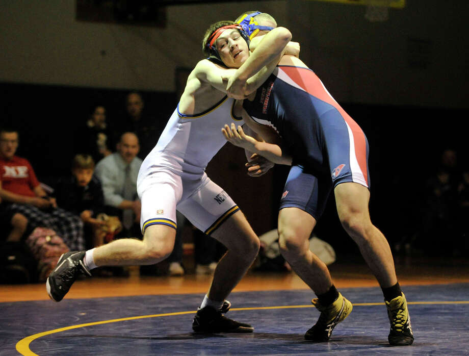 Newtown's Forrest Speed, in white, and New Fairfield's Mikey Amorando wrestle in the 170-pound weight class during their dual meet at Newtown High School on Thursday, Jan. 3, 2013. New Fairfield won, 57-21. Photo: Jason Rearick / The News-Times