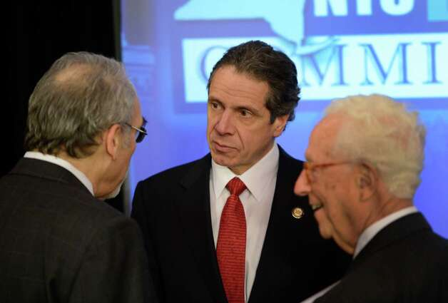 Governor Andrew Cuomo speaks to Dr. Irwin Fedlener, left and Ira Millstein Co-Chairss of the NYS Ready Commission after presiding over a cabinet meeting held Jan 3, 2013 at the State Capitol in Albany, N.Y.   (Skip Dickstein/Times Union) Photo: SKIP DICKSTEIN