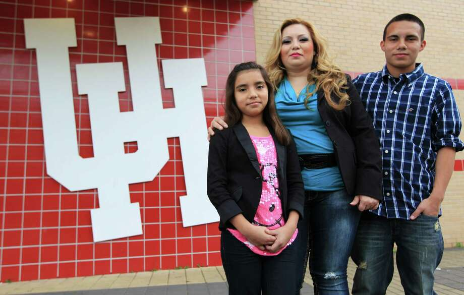 Liz Rubio with her two children Lizet Rosendo, 10, and Raul Rosendo, 14, on the University of Houston campus. Rubio, a Conroe mother who didn't let anything -- not discrimination, poverty, teen pregnancy, or full-time jobs -- get in the way of her goal to graduate from college, which she should do in May. Photo: Karen Warren, Houston Chronicle / © 2012 Houston Chronicle