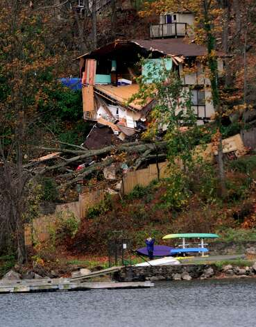 This house overlooking Candlewood Lake near the Pleasant Acres Beach in Danbury was heavily damaged reportedly by falling trees from the high winds of Hurricane Sandy, Tuesday, Oct. 30, 2012. Photo: Carol Kaliff / The News-Times
