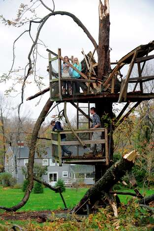 The Haynes children, Walker, 18, Haden, 14, Amelia, 15, and Lydia, 16, stand in what was a three-story tree house that Walker and his father, Doug, built in 2006 at their Ridgefield, Conn. home, Tuesday, Oct. 30, 2012. The tree house was destroyed during the high winds of Hurricane Sandy. Photo: Carol Kaliff / The News-Times