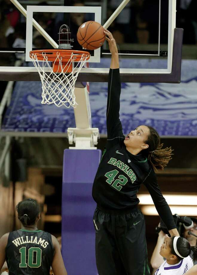 Brittney Griner led Nimitz High School to an appearance at the 5A state championship game. At Baylor she has won a national championship and racked up numerous awards. Photo: Tony Gutierrez, Associated Press / AP