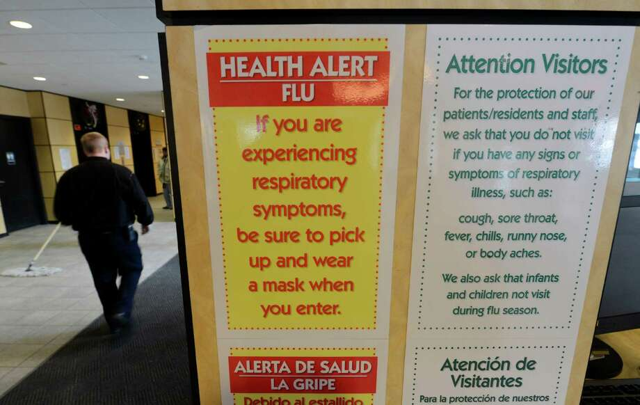 Signs in the lobby of Samaritan Hospital Jan 2, 2013 in Troy, N.Y. alert people entering the facility to the dangers of having the flu and visiting the hospital.  (Skip Dickstein/Times Union) Photo: SKIP DICKSTEIN / 00020632A
