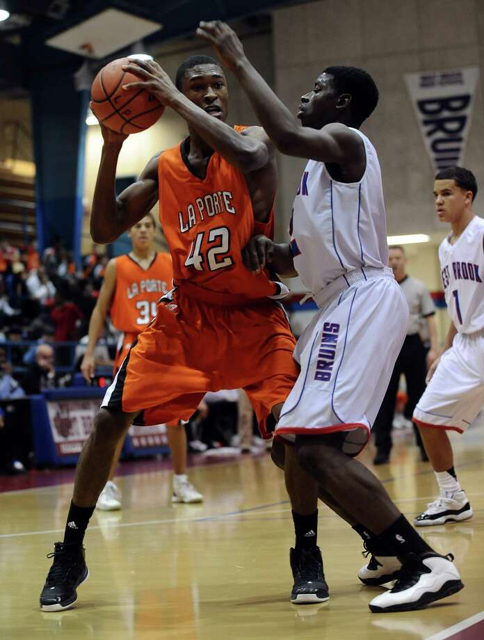 La Porte Alonzo Allen, #42, looks for an open teammate  drives to the goal during the West Brook High School basketball game against the La Porte High School on Thursday, January 3, 2013, at West Brook High School. West Brook won over La Porte 63 - 49. Photo taken: Randy Edwards/The Enterprise Photo: Randy Edwards