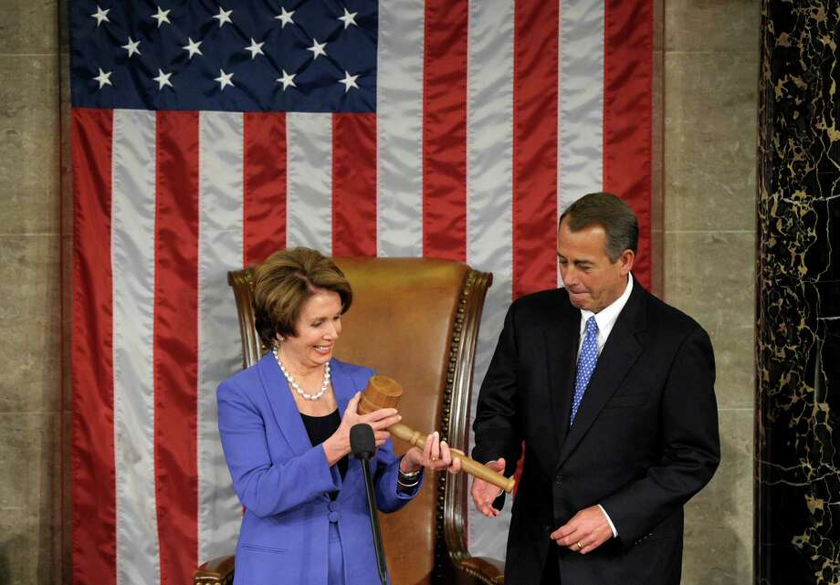 House Minority Leader Nancy Pelosi of Calif. passes the gavel to House Speaker John Boehner of Ohio, who was re-elected as House Speaker of the 113th Congress, Thursday, Jan. 3, 2013, on Capitol Hill in Washington. (AP Photo/Susan Walsh) Photo: Susan Walsh