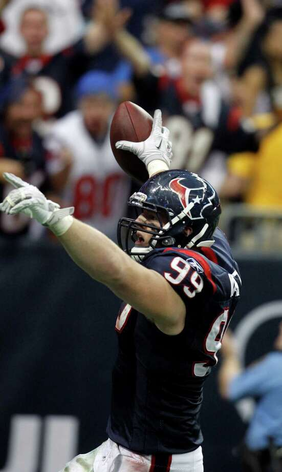 Texans defensive end J.J. Watt celebrates after returning an interception 29 yards for a touchdown against the Bengals in last season's wild-card victory at Reliant Stadium. Photo: Karen Warren, Staff / © 2012  Houston Chronicle