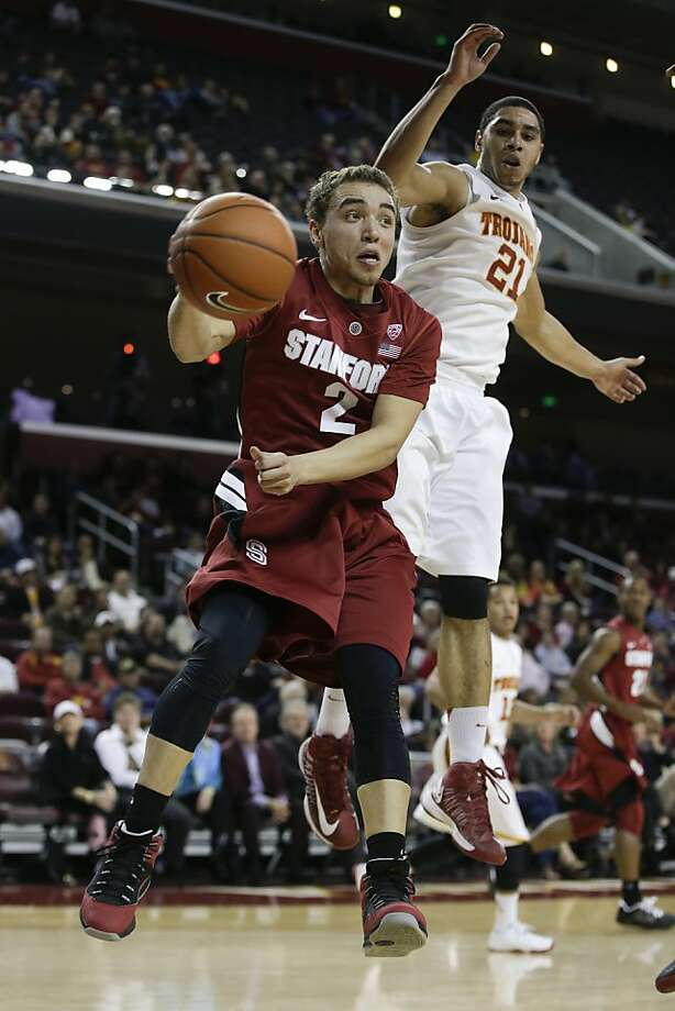 Stanford guard Aaron Bright, left, passes around Southern California forward Aaron Fuller during the first half of an NCAA college basketball game in Los Angeles, Thursday, Jan. 3, 2013. (AP Photo/Chris Carlson) Photo: Chris Carlson, Associated Press
