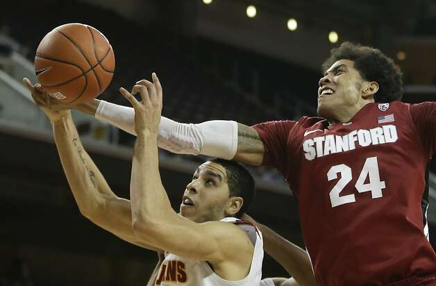 Stanford forward Josh Huestis, right, pulls a rebound away from Southern California forward Aaron Fuller during the first half of an NCAA college basketball game in Los Angeles, Thursday, Jan. 3, 2013. (AP Photo/Chris Carlson) Photo: Chris Carlson, Associated Press