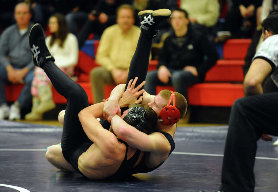 Foran's Clay Callahan rolls Jonathan Law's Kurt Holden onto his back for a pin attempt, during wrestling action in Milford Conn. on Thursday January 3, 2013. Photo: Christian Abraham / Connecticut Post