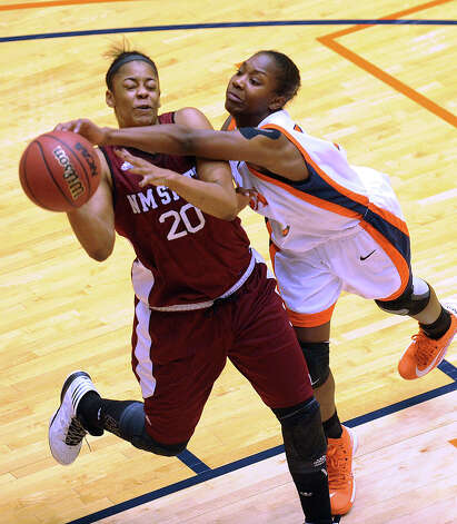 UTSA's Niaga Mitchell-Cole (12) knocks the ball away from Stefanie Gilbreath of NMSU during Western Athletic Conference action at the UTSA Convocation Center on Thursday, Jan. 3, 2013. Photo: Billy Calzada, Express-News / SAN ANTONIO EXPRESS-NEWS