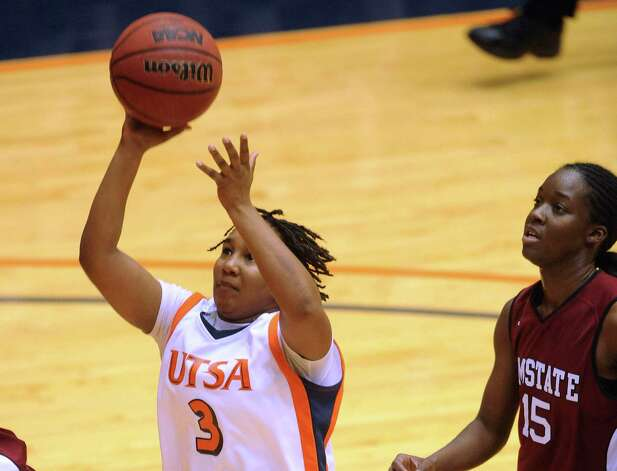 Jermini Malone (3) of UTSA shoots  as Jasmine Rutledge (15) of NMSU chases during Western Athletic Conference action at the UTSA Convocation Center on Thursday, Jan. 3, 2013. Photo: Billy Calzada, Express-News / SAN ANTONIO EXPRESS-NEWS