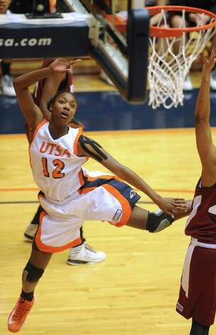Niaga Mitchell-Cole of UTSA watches her shot fly during Western Athletic Conference action against NMSU at the UTSA Convocation Center on Thursday, Jan. 3, 2013. Photo: Billy Calzada, Express-News / SAN ANTONIO EXPRESS-NEWS