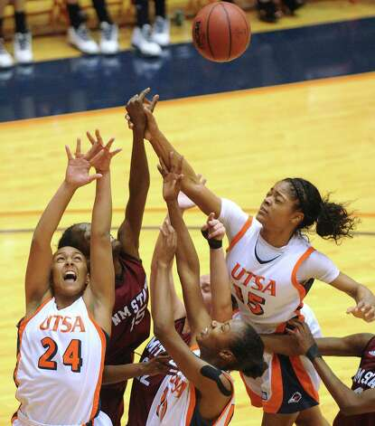 A trio of UTSA Roadrunners, Ashley Spaletta (24), Niaga Mitchell-Cole (12) and Simone Young (15) battle for a rebound against NMSU during Western Athletic Conference action at the UTSA Convocation Center on Thursday, Jan. 3, 2013. Photo: Billy Calzada, Express-News / SAN ANTONIO EXPRESS-NEWS