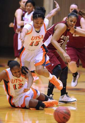 UTSA's Simone Young (15) chases a loose ball by teammate Niaga Mitchell-Cole (12) during Western Athletic Conference action against New Mexico State at the UTSA Convocation Center on Thursday, Jan. 3, 2013. Photo: Billy Calzada, Express-News / SAN ANTONIO EXPRESS-NEWS