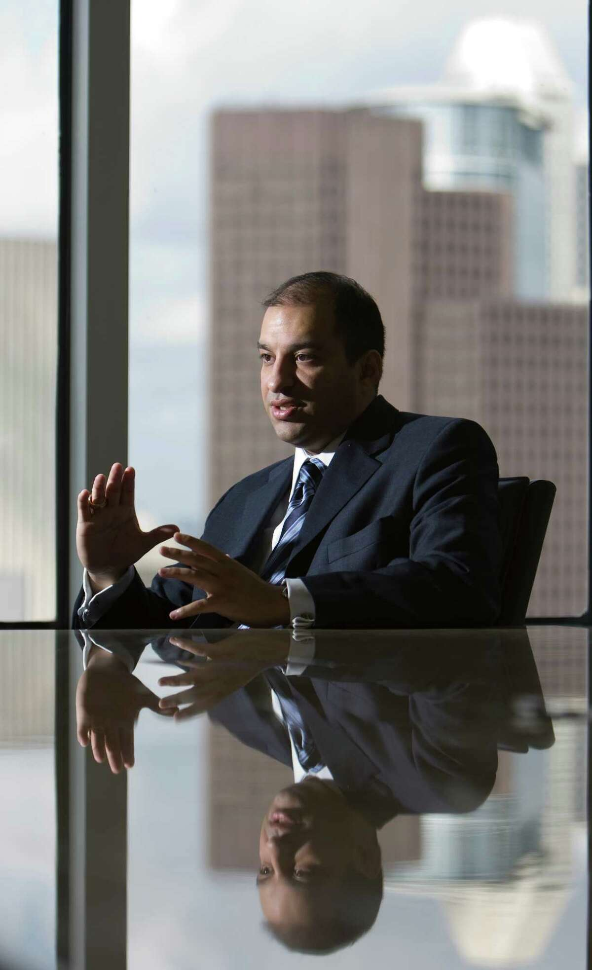 Alberto Cardenas, Jr., (cq), executive council of Americans for Immigration Reform, talks about his views on the U.S. current situation and how hopes for the future Friday, Aug. 22, 2008, in Houston. ( Nick de la Torre / HOUSTON CHRONICLE )