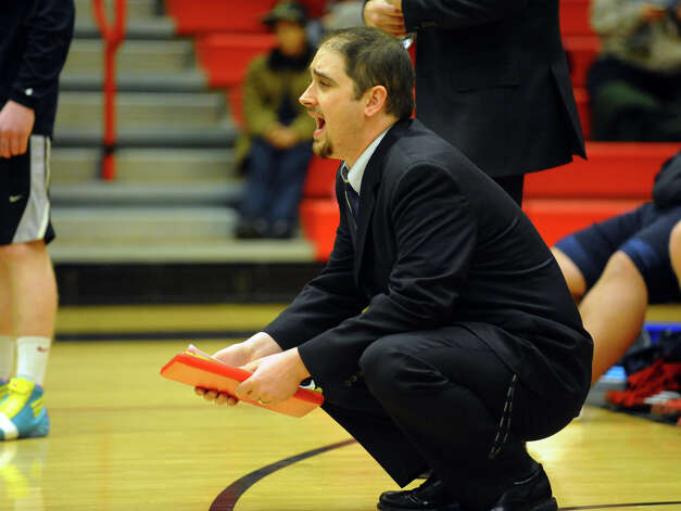 Foran Head Coach Frank Peters, during wrestling action against Jonathan Law in Milford Conn. on Thursday January 3, 2012. Photo: Christian Abraham / Connecticut Post