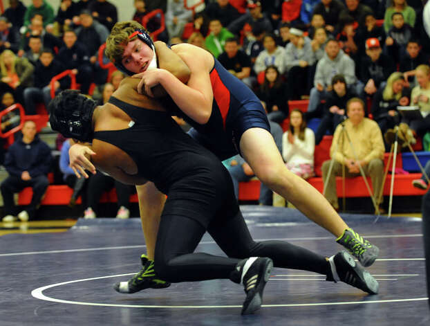 Foran's Luke Edmondson, top, and Law's Phil Centore, during wrestling action in Milford Conn. on Thursday January 3, 2012. Photo: Christian Abraham / Connecticut Post